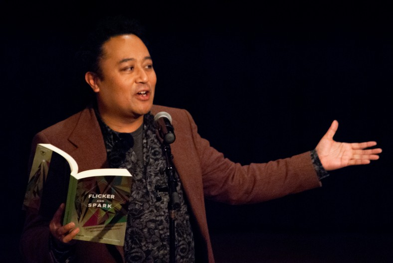 Poet Regie Cabico reading from the Queer poetry anthology he edited. Photo copyright 2013 by Alli Ownby, used by permission of Regie Cabico.